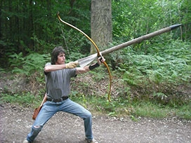 Chris at one with bow & arrow
