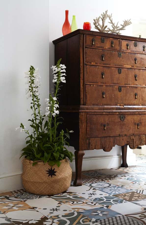 Chest of draws next to seagrass belly basket with plant