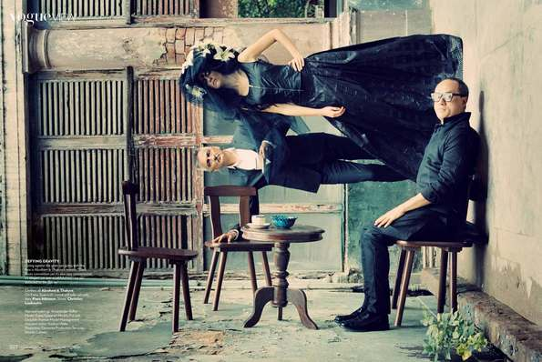 Inception inspired anti gravity image with two men and a woman in black clothes